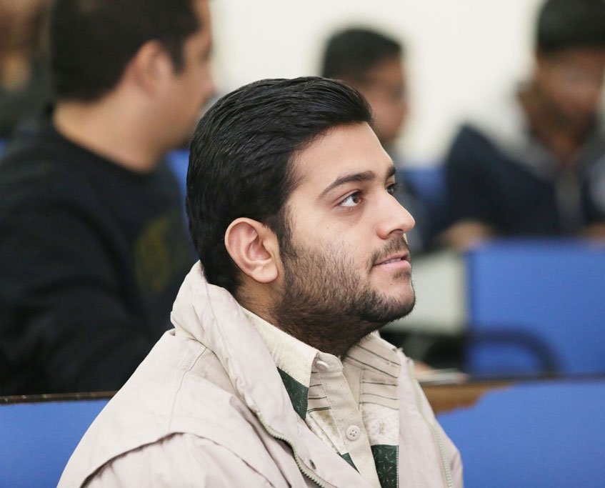 Awais Naeem Concentrating During a Lecture