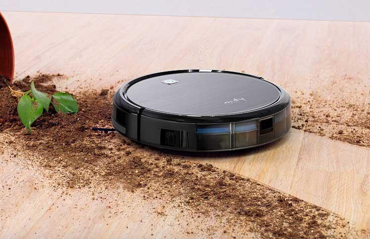 Robotic Vacuum Cleaner sucking Dirt off the Floor